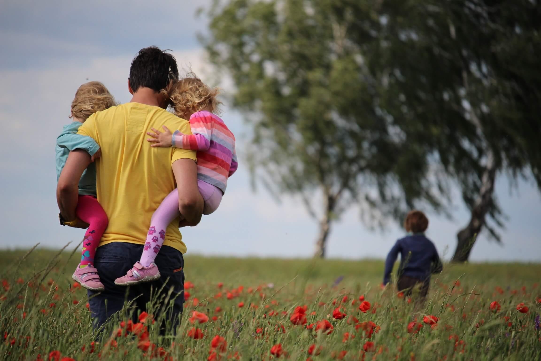 Family in poppy field